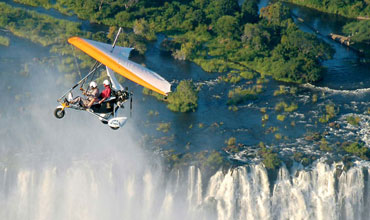 Flying over the Victoria Falls in a Microlight